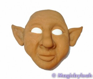 Painting polymer clay reference face out of the oven