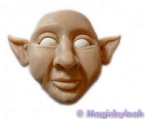 polymer clay reference face forming the ears