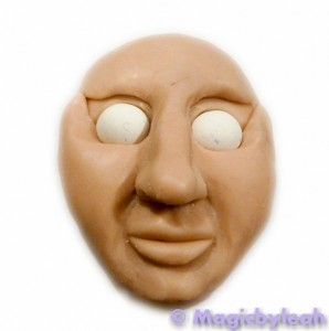 polymer clay reference face with larger eyeballs