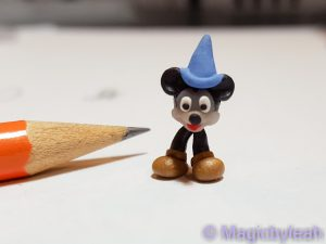 tiny Mickey Mouse with legs